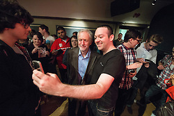 © Licensed to London News Pictures . 25/07/2015 . Warrington , UK . JEREMY CORBYN poses for selfies with supporters after the Labour Party leadership hustings at Parr Hall in Warrington . Photo credit : Joel Goodman/LNP
