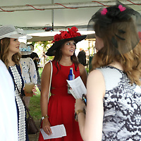 Lee Kelso, far right, and Lindsey Groome chat with attendees of Saturday's 20th annual Kentucky Derby Party to benefit Regional Rehabilitation Center