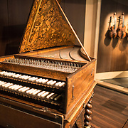 An ornate keyboard instrument on display at the Musical Instrument Museum in Brussels. The Musee des Instruments de Musique (Musical Instrument Museum) in Brussels contains exhibits containing more than 2000 musical instruments. Displays include historical, exotic, and traditional cultural instruments from around the world. Visitors to the museum are given handheld audio guides that play musical demonstrations of many of the instruments. The museum is housed in the distinctive Old England Building.