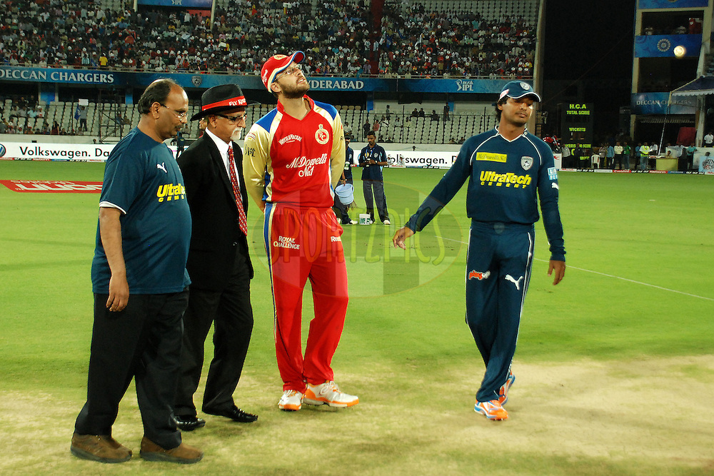 toss, Sangakara(r), vettori(m), and others looking at the coin during match 11 of the Indian Premier League ( IPL ) between the Deccan Chargers and the Royal Challengers Bangalore held at the Rajiv Gandhi International Cricket Stadium in Hyderabad on the 14th April 2011..Photo by Saikat Das/BCCI/SPORTZPICS