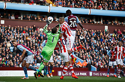 Stoke Goalkeeper Asmir Begovic (BIH) beats Aston Villa Forward Christian Benteke (BEL) to the ball - Photo mandatory by-line: Rogan Thomson/JMP - 07966 386802 - 23/03/2014 - SPORT - FOOTBALL - Villa Park, Birmingham - Aston Villa v Stoke City - Barclays Premier League.