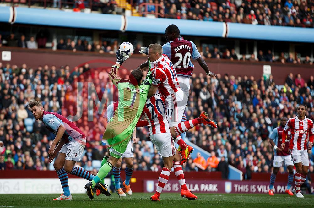 Stoke Goalkeeper Asmir Begovic (BIH) beats Aston Villa Forward Christian Benteke (BEL) to the ball - Photo mandatory by-line: Rogan Thomson/JMP - 07966 386802 - 23/03/2014 - SPORT - FOOTBALL - Villa Park, Birmingham - Aston Villa v Stoke City - Barclays Premier League.