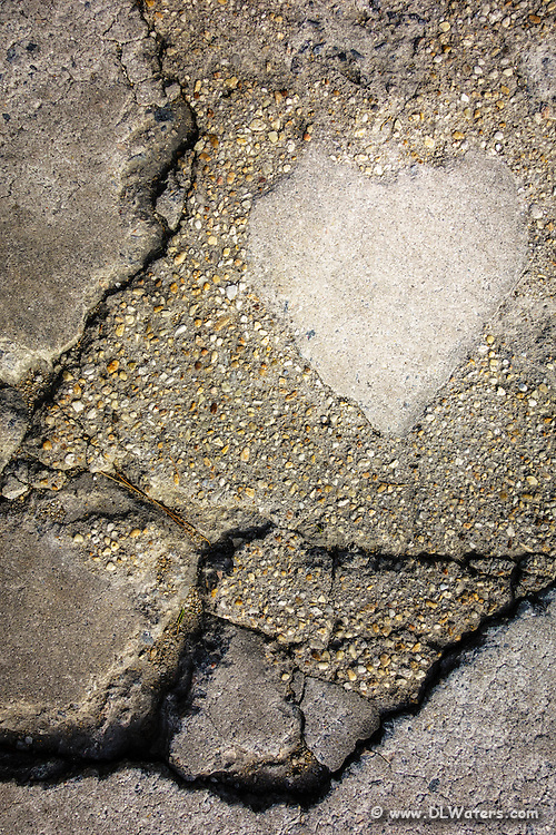 A heart-shaped concrete patch on a Outer Banks parking lot.
