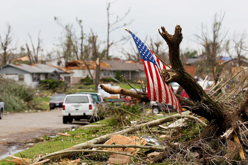May 24, 2011- An American flag is attached to a tree in one of the many destroyed neighborhoods in Joplin, Missouri after a Tornado came through the town on Sunday, May 22, 2011. Credit: David Welker / TurfImages.com