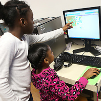 Lauren Wood | Buy at photos.djournal.com<br /> Yazmine Triplett, left, helps Charbrelle Houston write code to move the Angry Bird Tuesday during the Hour of Code in Ragen Lambert's first grade classroom at Carver Elementary School.