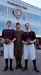"""Fringe performers pose outside Tynecastle Stadium.<br /> <br /> """"A War of Two Halves"""" tells the story of the 1914-15 Heart of Midlothian Team who signed up en masses to McCrae's Battalion <br /> <br /> Pictured: (l to r) Paul Beeson, Bryan Low and Charlie Wake.<br /> <br /> Alex Todd 