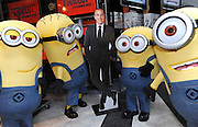"The Minions pose with Matt Lauer at the NBC Experience Store, Monday, Nov. 25, 2013, in New York, to celebrate the release of ""Despicable Me 2"" on Digital HD on November 26 and Blu-ray and DVD on December 10.  The Minions took over Manhattan in preparation for their appearance in the 84th annual Macy's Thanksgiving Day Parade.  (Photo by Diane Bondareff/Invision for Universal Studios Home Entertainment/AP Images)"