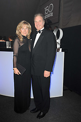 Chair of Battersea Dogs & Cats Homes Trustees HEATHER LOVE and her husband JONATHAN VINEHALL at the Collars & Coats Gala Ball celebrating 150 years of Battersea Dogs & Cats Home held at Battersea Power Station, London on 25th November 2010.