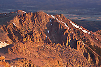 Looking north toward the Rampart Range from the summit of 14,110 ft. Pikes Peak at sunrise. Colorado.