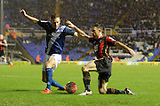 Birmingham City defender Michael Morrison attempts to block Bournemouth midfielder Marc Pugh during the The FA Cup third round match between Birmingham City and Bournemouth at St Andrews, Birmingham, England on 9 January 2016. Photo by Alan Franklin.
