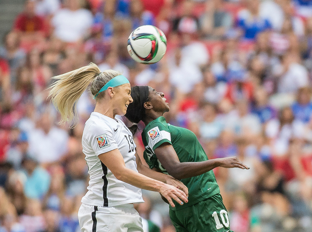 Julie Johnston of team USA (left) and Courtney Dike of team Nigeria in 2015 women's World Cup Soccer in Vancouver during the first round action between USA and Nigeria.