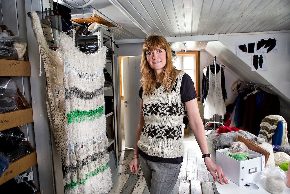 Torshavn, Streymoy Island, Faroe Islands<br /> <br /> Gudrun Ludvig, 45,  stands in her old workshop in the attic of the Gudrun &amp; Gudrun store located on the main shopping street in the center of Torshavn.   With a large new workspace across the street, Gudrun no longer uses her old workshop to knit in, but she still keeps it filled with product and wool as it was where her business began.