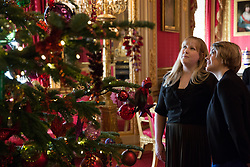 Windsor, UK. 30th November, 2018. The State Apartments at Windsor Castle have been decorated with glittering Christmas trees and twinkling lights for Christmas. Seen here a 15ft Christmas tree in the Crimson Drawing Room (a Semi-State Apartment open to castle visitors during the winter months). A 20ft Nordmann Fir tree also stands in St George's Hall dressed in gold decorations.