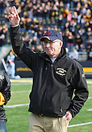 November 12, 2011: Former Iowa wrestling coach Dan Gable waves to the crowd before the start of the NCAA football game between the Michigan State Spartans and the Iowa Hawkeyes at Kinnick Stadium in Iowa City, Iowa on Saturday, November 12, 2011. Michigan State defeated Iowa 37-21.