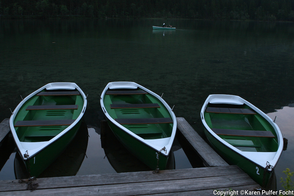 Boats rest in front of the Alpenhof Guesthouse ,  in Hintersee, Bavaria, Germany. The guest house was once visited by Adolph Hitler. It was also Hitlers Headquarters at the end of the war. All the Hitlers generals that were at the Berghof, moved in here at the very end of the war. It is near the Austrian border. It is situated in the heart of the Bavarian Alps.