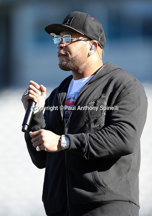 Halftime rapper performer Flo Rida warms up before the Carolina Panthers NFC Divisional Playoff NFL football game against the San Francisco 49ers on Sunday, Jan. 12, 2014 in Charlotte, N.C. ©Paul Anthony Spinelli