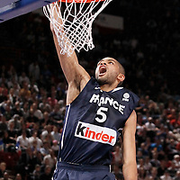15 July 2012: Nicolas Batum of Team France dunks the ball during a pre-Olympic exhibition game won 75-70 by Spain over France, at the Palais Omnisports de Paris Bercy, in Paris, France.