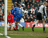 Photo. Chris Ratcliffe<br />Charlton v Birmingham. FA Premiership. 19/04/2003<br />Christophe Dugarry turns to celebrate whilst Dean Kiely and Luke Young cannot hide their frustration