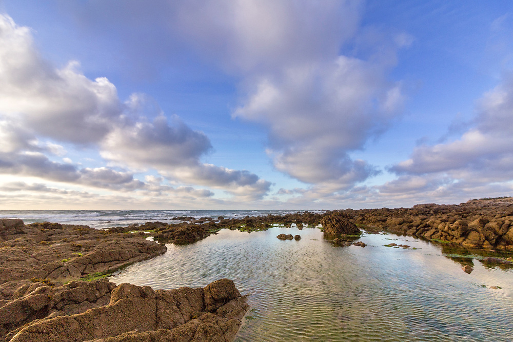 Cloundscape Atlantic Ocean view at Dar Bouazza rocky beach, in Casablanca south coast. Morocco.