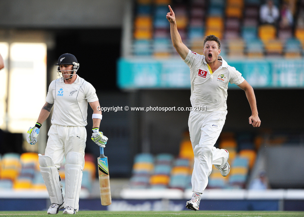 Australian bowler James Pattinson celebrates the dismissal of Brendon McCullum on Day 3 of the first cricket test between Australia and New Zealand Black Caps at the Gabba in Brisbane, Thursday 1 December 2011. Photo: Andrew Cornaga/Photosport.co.nz