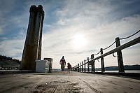 JEROME A. POLLOS/Press..Nicole Pierson walks along the floating boardwalk Thursday in downtown Coeur d'Alene with her dog Marley. The 3,300-foot-long landmark will close within the next day or so to replace worn beams on the boardwalk.