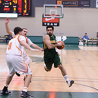 4th year guard Alex Igual (4) of the Regina Cougars during the 5th year night on February  11 at Centre for Kinesiology, Health and Sport. Credit: Arthur Ward/Arthur Images