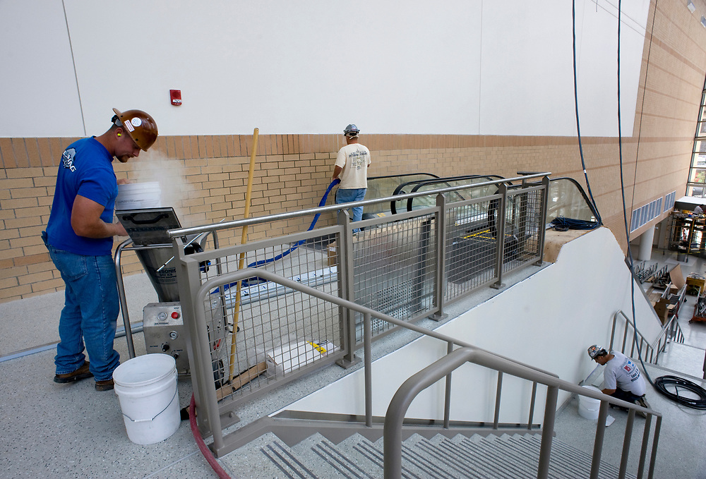 Laborers clean brickwork with dry ice inside the Consol Energy Center. The arena can seat over 18,000 and is scheduled to open August 18, 2010.