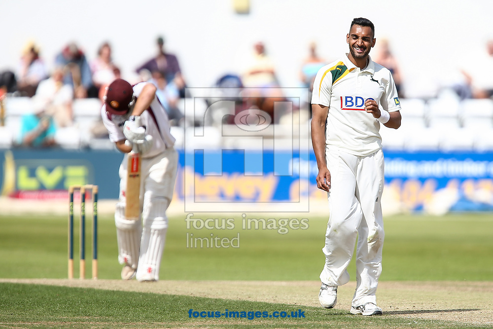 Ajmal Shahzad of Nottinghamshire County Cricket Club (right) during the LV County Championship Div One match at the County Ground, Northampton.<br /> Picture by Andy Kearns/Focus Images Ltd 0781 864 4264<br /> 17/08/2014
