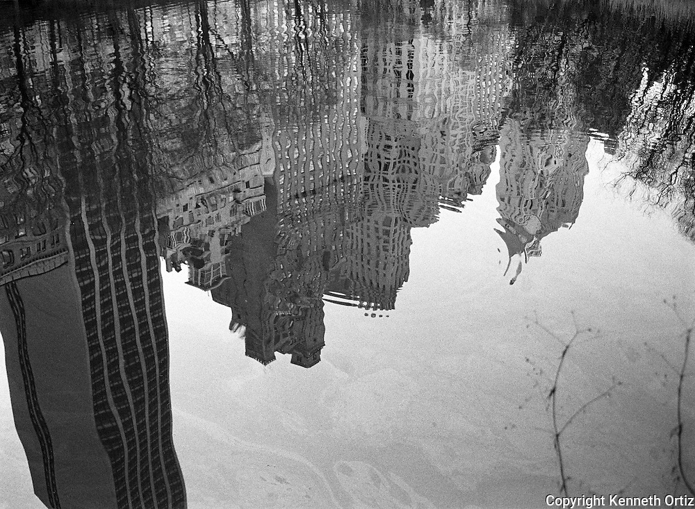 A reflection of Central Park South.
