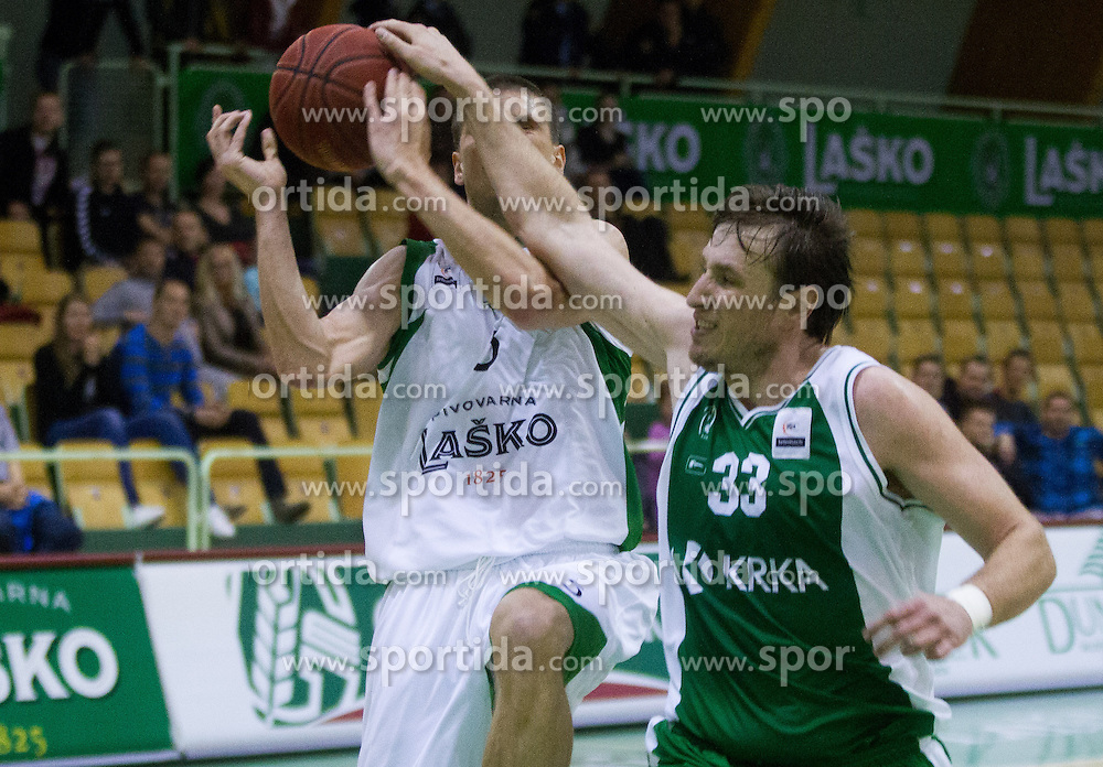 Jaka Brodnik of Lasko faulted by Matjaz Smodis of Krka during basketball match between KK Zlatorog Lasko and KK Krka Novo mesto in 2nd Round of semifinal of Slovenian National Championship - Telemach League 2012/2013, on May 7, 2013, in Arena Tri Lilije, Lasko, Slovenia. (Photo By Vid Ponikvar / Sportida.com)