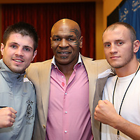 Ievgin Khytrov, Mike Tyson and Sammy Vasquez, Jr pose during the Iron Mike Productions, ESPN Friday Night Fights boxing match at Turning Stone Resort Casino on Friday, June 6, 2014 in Verona, New York.  (AP Photo/Alex Menendez)