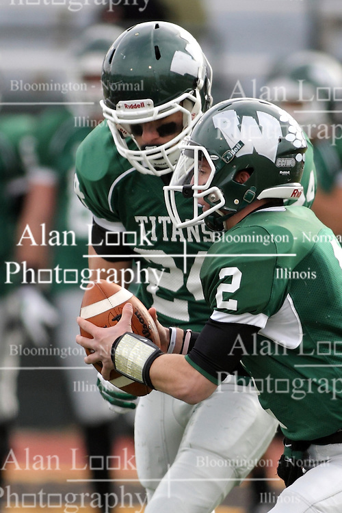 15 November 2014:  Jack Warner appears to hand off to Austin Harrell during an NCAA division 3 football game between the North Park Vikingsand the Illinois Wesleyan Titans in Tucci Stadium on Wilder Field, Bloomington IL