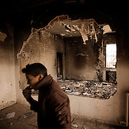 TUNISIA, Kef : A child stands  among the debris of a police station burnt during clashes on the eve between protesters and police in Kef, northern Tunisia.  Copyright Christian Minelli.