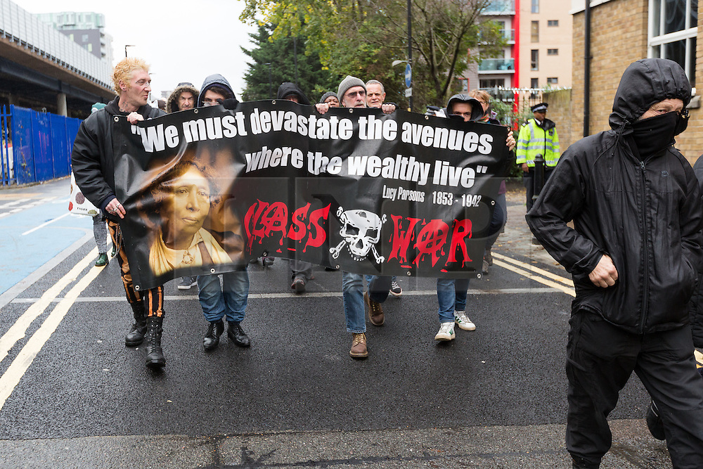 © Licensed to London News Pictures. 07/11/2015. London, UK. Class War and supporters arrive to stage a protest outside the Jack the Rippper Museum in Cable Street, Shadwell, east London. Protesters want to shut the museum down, accusing museum owner, Mark Palmer-Edgecumbe of glorifying rape and sexual violence against women. The original planning application for the museum submitted to Tower Hamlets council stated that it would celebrate the lives and history of east end women. This week a retrospective planning application for the museum sign and frontage was refused by the council.  Photo credit : Vickie Flores/LNP