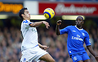 12/5/2004 - Chelsea v  Everton , Stamford Bridge - FA Barclays Premiership.<br />Everton's Tim Cahill and Chelsea's Claude ~Makelele both chase the bouncing ball<br />Photo:Jed Leicester/Back Page Images