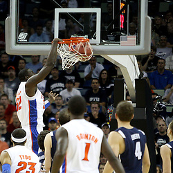 Mar 24, 2011; New Orleans, LA; Florida Gators center Vernon Macklin (32) dunks Brigham Young Cougars  during the first half of the semifinals of the southeast regional of the 2011 NCAA men's basketball tournament at New Orleans Arena.  Mandatory Credit: Derick E. Hingle