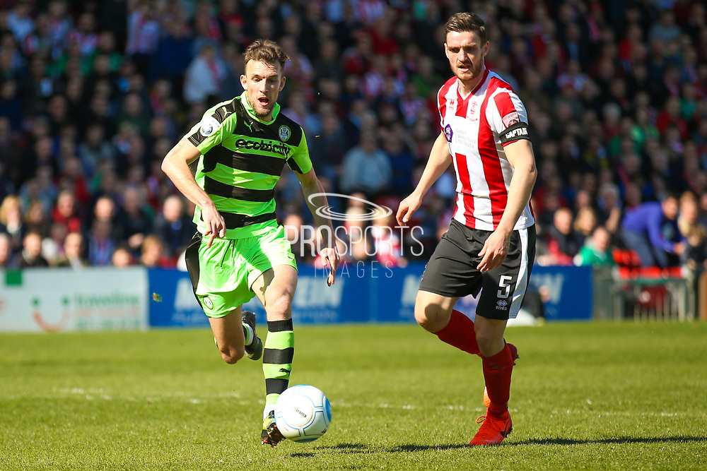 Forest Green Rovers forward Christian Doidge (9) pounces onto the ball to score a goal to make the score 0-1 during the Vanarama National League match between Lincoln City and Forest Green Rovers at Sincil Bank, Lincoln, United Kingdom on 25 March 2017. Photo by Simon Davies.