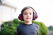 Cousin Sabina with noise cancellation headphones on in the yard of the family house