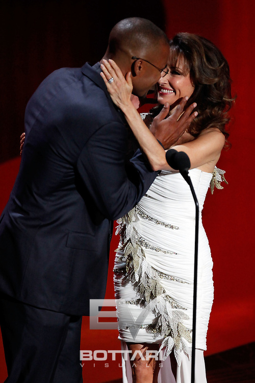From left, actors Shemar Moore and Susan Lucci embrace onstage during the Daytime Emmy Awards on Sunday June 19, 2011 in Las Vegas. (AP Photo/Jeff Bottari)