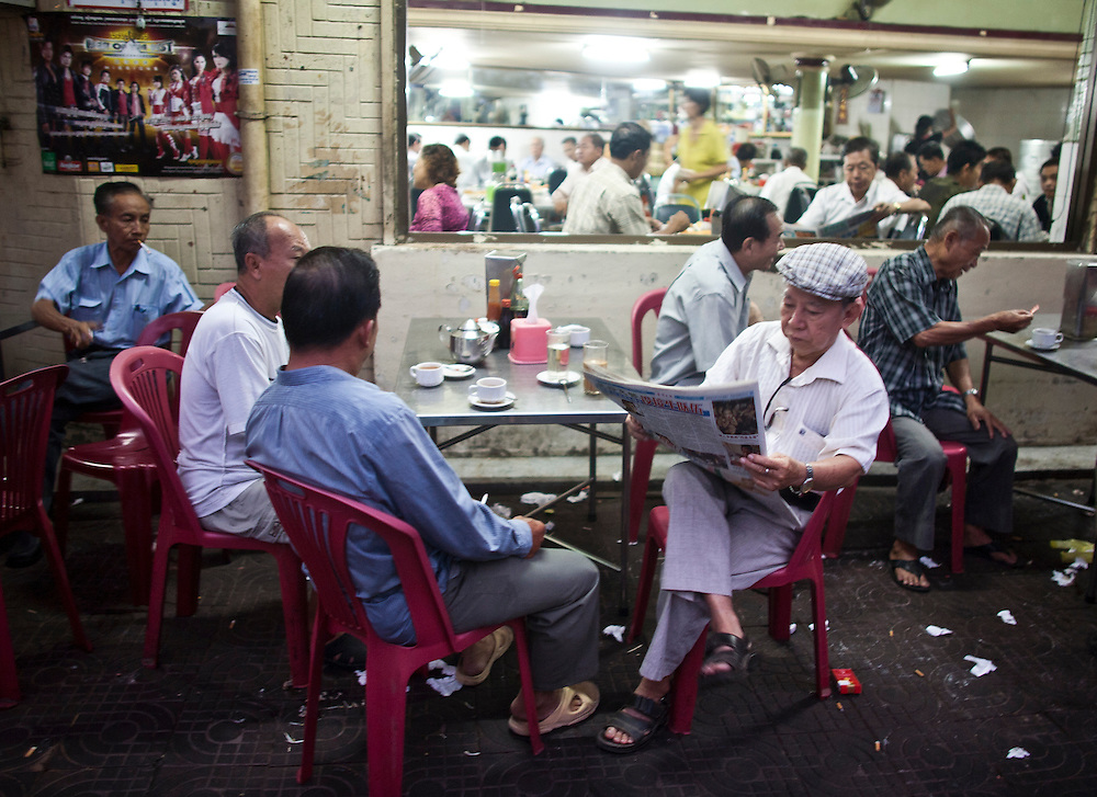 Older Cambodia men gather to read the morning papers in Phnom Penh, Cambodia.