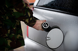 © London News Pictures. 06/01/2011. FILE PICTURE. A  Motorist filling his car with petrol in Upton Upon Severn. Workers should expect another year of pain, with pay freezes or pay rises well below inflation, researchers have claimed. People are already struggling to make ends meet on their current salary, particularly following the recent rises in VAT and petrol prices. Photo credit should be read: David Hedges/LNP...Motorists were queueing for petrol at a Hertford petrol station on the A414 on Christmas Eve before travelling on Christmas Day.