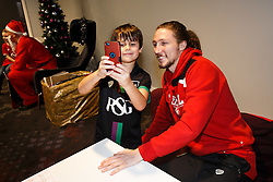 Luke Ayling of Bristol City takes a selfie with a young fan as Season ticket holders and members of Bristol Sport 7s and Forever Bristol take part in a Bristol Sport Christmas Party - Mandatory byline: Rogan Thomson/JMP - 22/12/2015 - SPORT - Ashton Gate Stadium - Bristol, England - Bristol Sport Christmas at Ashton Gate.