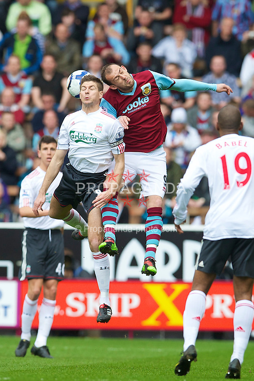 BURNLEY, ENGLAND - Sunday, April 25, 2010: Liverpool's captain Steven Gerrard MBE and Burnley's Steven Fletcher during the Premiership match at Turf Moor. (Photo by David Rawcliffe/Propaganda)
