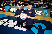 ANZ Future Captains Gabby Allerby aged 10 (L) and Madeleine Lord aged 12 (R). 2015 ANZ Championship, Northern Mystics v Queensland Firebirds, The Trusts Arena, Auckland, New Zealand. 26 April 2015. Photo: Anthony Au-Yeung / www.photosport.co.nz