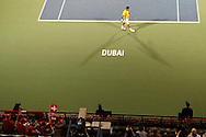 Dubai Tennis Championships 2011, ATP Tennis Turnier,International Series,Dubai Tennis Stadium, U.A.E.,Dubai Tennis Championships 2011, ATP Tennis Turnier,International Series,Dubai Tennis Stadium, U.A.E., vorne links eine Gruppe Schweizer Fans mit Fahnen unterstuetzen Roger Federer (SUI) im Match gegen Somdev Devvarman(IND),von oben,Uebersicht,