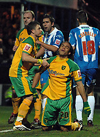 Photo: Ashley Pickering/Sportsbeat Images.<br /> Colchester United v Norwich City. Coca Cola Championship. 15/12/2007.<br /> Darel Russell of Norwich (no. 20) is helped to his feat by Jamie Cureton after he misses a great chance