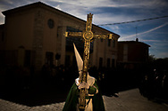Holy Week in Spain<br /> <br /> Hundreds of processions take place throughout Spain during the Easter Holy Week. <br /> <br /> A penitent of the 'Virgen de la Esperanza' brotherhood marches carrying a cross as he takes part in a Holy Week procession in Zamora, Spain, Thursday, April 2, 2015.