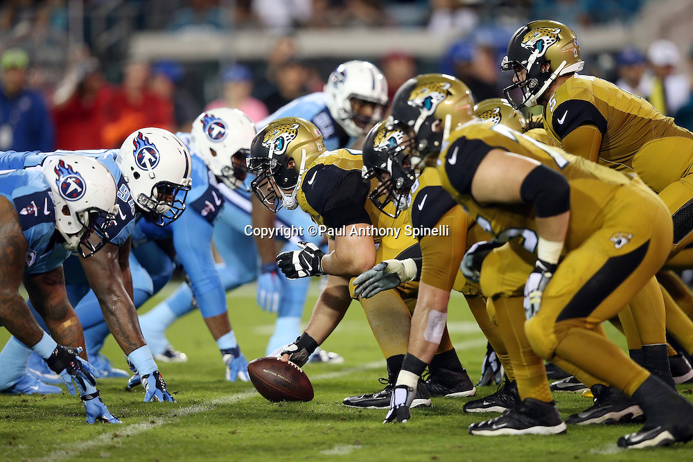 The Jacksonville Jaguars offensive line gets set to snap the ball opposite the Tennessee Titans defensive line during the 2015 week 11 regular season NFL football game against the Tennessee Titans on Thursday, Nov. 19, 2015 in Jacksonville, Fla. The Jaguars won the game 19-13. (©Paul Anthony Spinelli)
