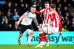 Martyn Waghorn of Derby County takes on Nick Powell of Stoke City - Mandatory by-line: Robbie Stephenson/JMP - 31/01/2020 - FOOTBALL - Pride Park Stadium - Derby, England - Derby County v Stoke City - Sky Bet Championship