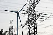Nederland, Eemshaven, 11 jan 2011.Energie. Hoogspanningsdraden en windmolen...Foto (c)  Michiel Wijnbergh